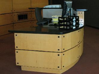 Maple Plywood Radius Reception Desk and Solid Surface Countertops