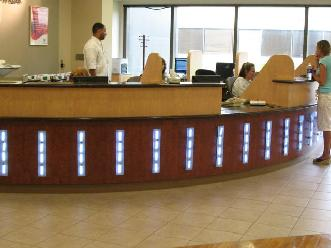 Radius Plastic Laminate Reception Wall, Plastic Laminate Privacy Panels, and Solid Surface Countertops