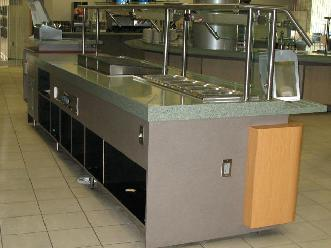 Plastic Laminate Servery Casework with Wood Stand-Off Panels and Solid Surface Countertop with Tray Slides